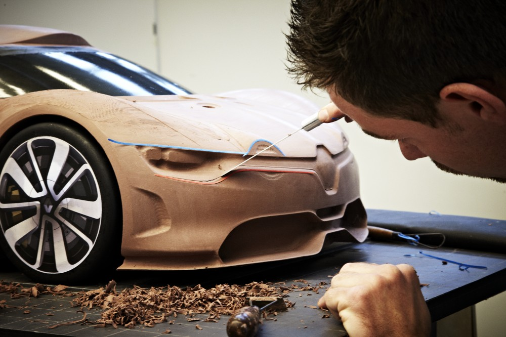 A designer and the Renault Alpine A110-50 in clay