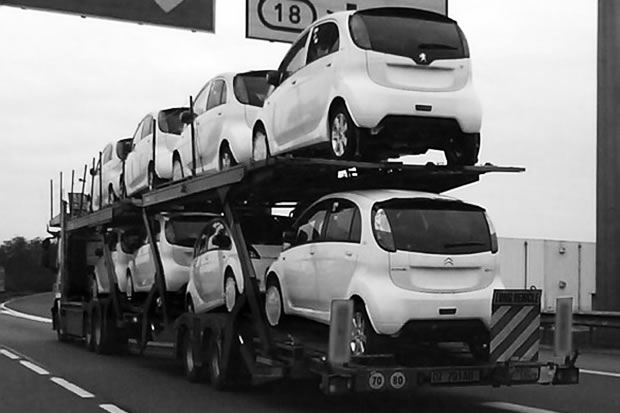 A truck full of Peugeot iOn