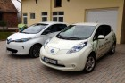 Renault ZOE and Nissan LEAF side to side.