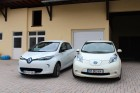Renault ZOE and Nissan LEAF side to side, in front of the garage.