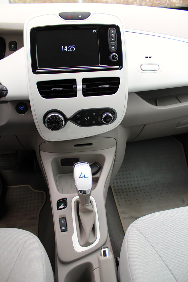 The car's gear lever and controls.
