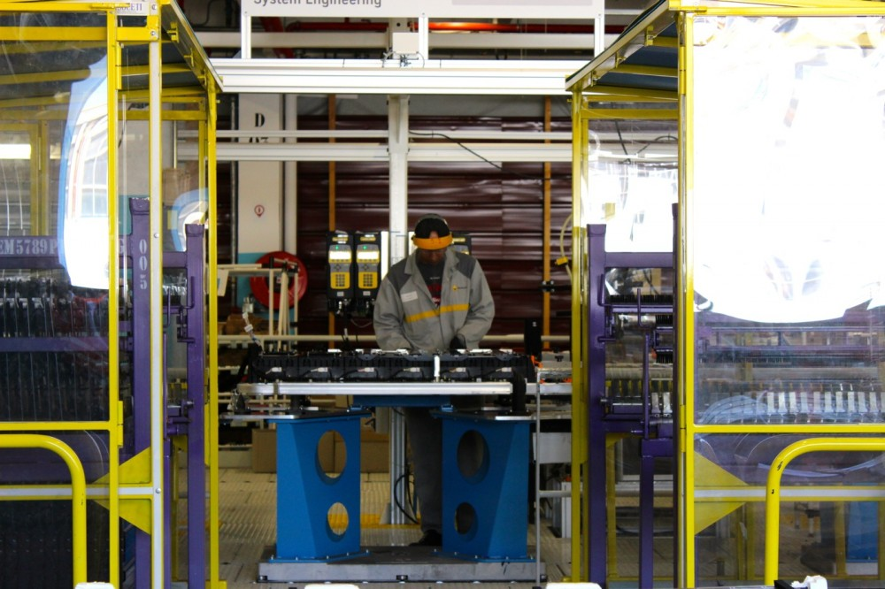 An operator working on a battery's assembly