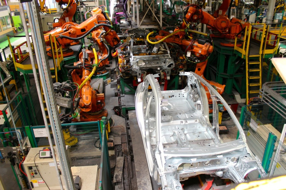 Robots busy working on bodyworks at Renault's plant in Flins